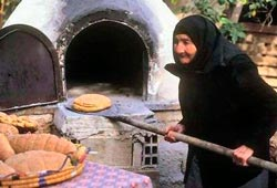 Baking bread the traditional way in a Cyprus village
